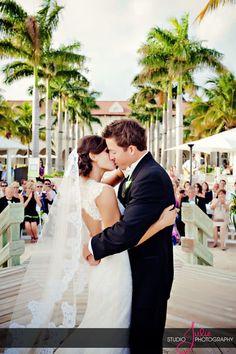 A Key West first kiss at a Casa Marina Resort wedding, photography by Studio Julie- www.studiojulie.com