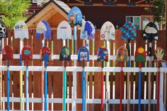 this display of colorfully painted shovels is at the Montessori Children's House of Denver