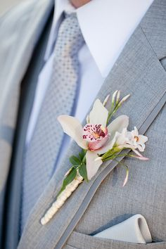 Orchid Boutonniere   photography by http://www.ashleybartoletti.com/
