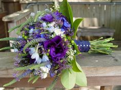 Blue Green Purple Yellow Bouquet Wedding Flowers Photos & Pictures - WeddingWire.com