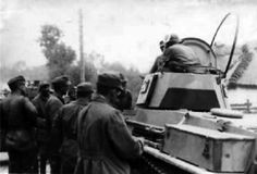 Hungarian soldiers and Toldi I light tank