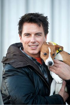 Entertainer John Barrowman is seen out promoting the Dog Trust, spreading the message A dog is for life, not just for Christmas. Barrowman happily posed with pups Mouse the Black Labrador and Vincent the Jack Russell Terrier.