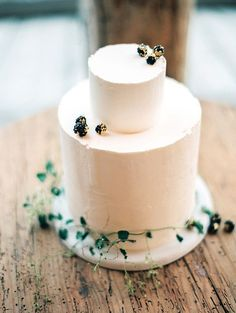 41 Edgy Modern Wedding Ideas You'll Love: simple frosted cake decorated with berries and greenery