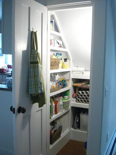 After - under stairs storage - smart little ledge on top of lower shelving