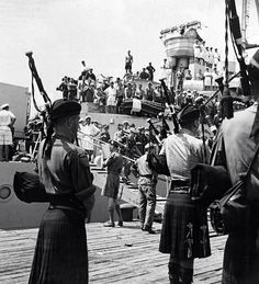 """Argyll and Sutherland bagpipers, Aug 29 1950, pipe ashore at Pusan, 1st Battalion Argyll and Sutherland Highlanders and 1st Btl Middlesex (London) Regiment, both British army regulars, the first allied ground forces to join the Americans and United Nations South Korean fighting forces.  The Argylls wore tam o'shanters, bush tunics, jungle-green shorts. Only the regimental pipers wore the traditional kilt, which in WWI earned Scots the nickname """"Ladies from Hell."""" TIME Monday, Sep. 11, 1950"""
