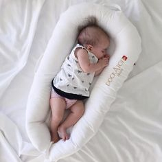 Another happy baby snuggles up for some rest time in her DockATot. One of the best new baby gear items for 2015, DockATot takes rest time seriously. It swaddles babies in comfort.