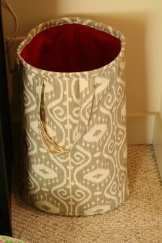 Hamper out of home dec fabric, fusible fleece and lining fabric with plastic tubing in top to make it stand up.