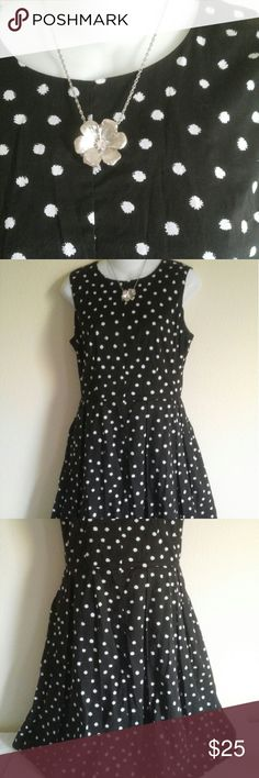 Cato black and white dress size 8 Cato black and with white polka dots dress in size 8. Very pretty and was used only once. A-line dress falls below knees. Zipper back, 100% cotton, mesh on top of fabric on back side, sleeveless, polyester lining. Cato Dresses Midi
