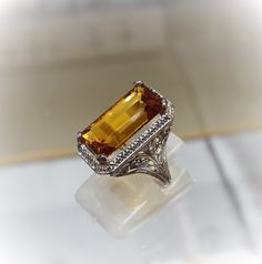 Rod Stelter Jeweler, Benbrook TX Vintage filigree ring in white gold with a new golden citrine.