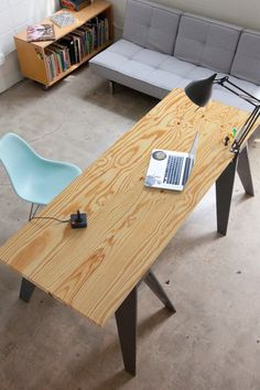 Modern rustic office | Eames molded plastic side chair | via Simply Grove (simplygrove.com)