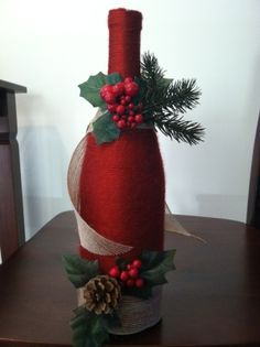 Decorate Christmas Bottles | This one is a wine bottle wrapped in yarn with some christmas decor ...