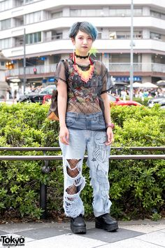 """tokyo-fashion: """" Chiharu on the street in Harajuku wearing a sheer """"Loser"""" top over a crop top, ripped jeans over fishnets, Yosuke platforms, and accessories from Dog Harajuku. Full Look """""""