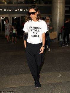 Smiling on the inside: Victoria once joked that she 'has a responsibility to the fashion c...
