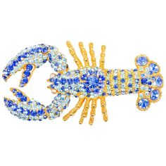 Vintage Lorenz Paris Gold Tone Blue Rhinestone Crystal Lobster Pin Brooch | From a unique collection of vintage brooches at https://www.1stdibs.com/jewelry/brooches/brooches/
