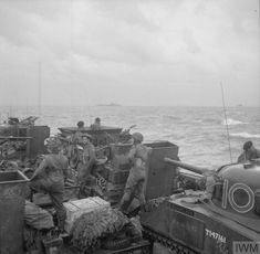 A landing craft en route for Normandy carrying Sherman tanks and other vehicles of 13th/18th Royal Hussars, 27th Armoured Brigade.