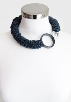 Short necklace made with a pure cotton paper ring and an aluminum ring surrounded by cotton fabric.Nickel free clasp.Length: 48cmPaper ring diameter: 5cm