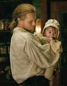There is something magical about tall, strong Scottish Highlander holding a baby that just take my breath away.Don't you think? James Fraser Outlander, Outlander Quotes, Outlander Tv Series, Sam Heughan Outlander, Highlands Warrior, Outlander Wedding, Jaime Fraser, Fraser Clan, The Fiery Cross