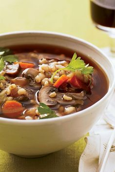This quick and easy 40-minute mushroom barley soup recipe incorporates carrots, celery, onions, mushrooms, barley and parsley to create the ultimate comfort food meets fall recipe. Whether you're looking to eat this barley soup recipe as a fast weeknight dinner or pack it for a fall lunch, it's a great choice for a comfort food recipe. #fallrecipes #comfortfood #souprecipes #barleysoup #barleysouprecipes Bean Soup Recipes, Wine Recipes, Cooking Recipes, Granola, Healthy Soup, Healthy Recipes, Healthy Foods, Healthy Eating, How To Cook Barley