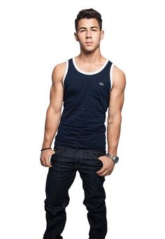 Nick Jonas Opens Up To Men's Fitness About Those Bulging Biceps And Jonas Brothers / Queerty
