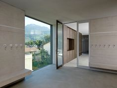 """The interior design of the primary school in Châteauneuf, Switzerland, was based on the colours of the facade and roof. The classrooms were designed with HPL natural fibre and equipped with the functions """"magnetic"""" and """"writable"""". Architect: savioz fabrizzi architectes, Sion, Switzerland #architecture #interiordesign #schoolarchitecture #ArgoliteHPL #design #designworld #classroomdesign Cabinet Fronts, School Building, Classroom Design, Wet Rooms, School Architecture, Primary School, Decoration, Switzerland, Facade"""