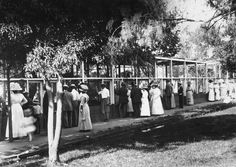 Visitors to Zapp's Park take in the attractions at the park's zoo, c. 1912.