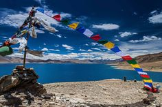 prayer flags at a lake in Ladakh Best Places To Travel, Places To See, Leh Ladakh, Flag Painting, Lacs, Prayer Flags, Tours, Tourist Spots, Travel Photographer
