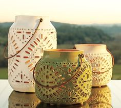 Perforated designs in the manner of Moroccan lanterns are punched through hot clay with a knife and awl to create the warm mood of candlelight in pottery. Our terra-cotta Punched Ceramic Lanterns are formed by hand and glazed in soft hues for indoor or outdoor use. From Pottery Barn.