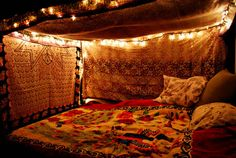 "date night ""Fort"" with lights as a romantic touch. All you need is an air mattress for maximum comfort!"