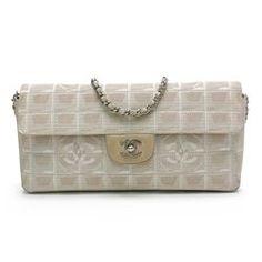 ca7550ea8932 Chanel Beige Canvas Travel Line East West Flap Bag
