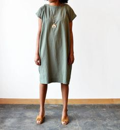Crinkled cotton dress with an optional pipped belt. UZI NYC was founded in 1993 by David Ball and Mari Gustafson on Colfax Avenue in Denver, Colorado. Before lo