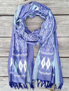 Passion Lilie fair trade 100% cotton light weight denim and teal ikat dyed scarf with tassels at the ends. Designed in New Orleans. Made in India.