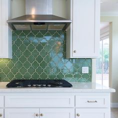 """""""We love this bright kitchen featuring our Ogee Drop in Kelp-where would you install this shape and color in your home? #recycled #handmade #tiles…"""""""