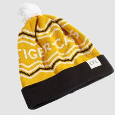 CFL Hamilton Tiger-Cats Toque. Dress in style this winter with the Tiger-Cats toque. Whether you're just walking through the streets of Hamilton or in the stands at Tim Hortons Field, make sure you #RepYourHood with this limited edition toque.  An official Tuck Shop and CFL collaboration.  Proudly Made in Canada. Tim Hortons, Hamilton, Beanie, Knitting, Cats, Collaboration, How To Make, Walking, Canada