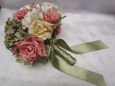 bouquet of silk flowers and a few small rhinestone brooches/scatter pins