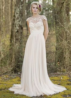 Hand beaded details adorn this English net slim A-line gown with an illusion beaded back, Jersey lining, and chapel length train. https://www.lillianwest.com/lillian_west/6470
