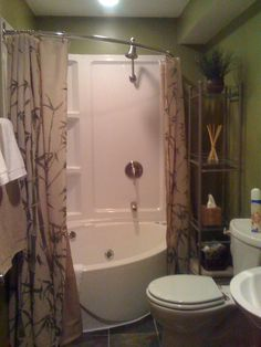 Whirlpool tub with round shower doors vanity and toilet of choice
