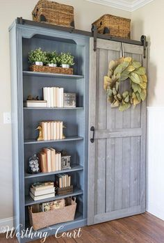 Farmhouse style bookcases with a diy sliding door Worthing Court Foyer Decorating, Farmhouse Style Decorating, Farmhouse Decor, Decorating Ideas, Decor Ideas, Vintage Farmhouse, Wall Ideas, Farmhouse Office Storage, Decorating Websites