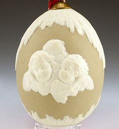 An Imperial Porcelain Factory Easter egg designed by August Spiess, 1860s-1870s. John Atzbach Antiques 1303-006.