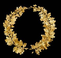 Golden wreath  Made from two hollow golden tubes, connected by two wires, made from golden oak leaves and acorns. It is 3.5cm in diameter (1 3/8 inch).  Greek  Greek Period, 4th century BC  Source: Museum of Fine Arts, Boston