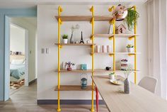 design attractor cupboard with yellow and wood