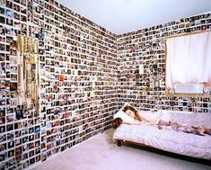 Love the idea of a photo wall... don't think I could do all four walls of a room though, it would drive me crazy but to do this to a small accent wall could be nice...