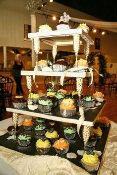 make it yourself cake tower  http://akroezen.wordpress.com/2012/03/16/diy-cupcake-tower/