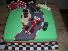 formula 1 racing car cake - racing car cake made for a 50th birthday.cars are made of fondant and flags of gum paste.thanks to natasja147 for the inspiration