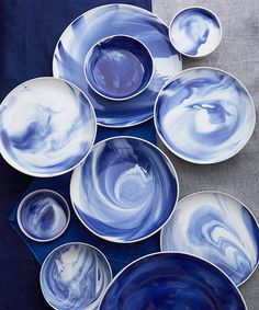 """The human hand can't do everything perfectly, and that's the beauty of it."" Lush marble indigo pottery by Simon Pearce.  -ñ"