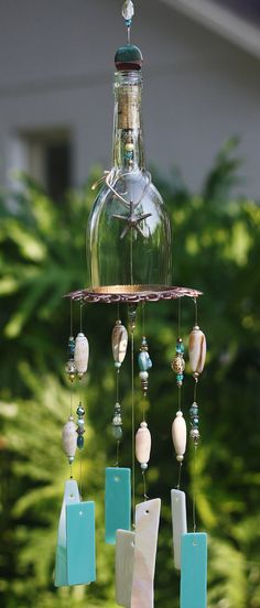 Wine Bottle Wind Chime - Bahama Breeze is made from Stained Glass, Clear Bottle, Unique Up-cycled Metal Piece and Beads. Indoor/Outdoor