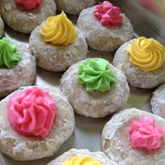 Spring inspired Mexican Wedding Cookies. Just follow the recipe for classic Mexican Wedding Cookies, but indent the cookies with your thumb before baking. After cooled, add some spring colored icing to the thumb indent.