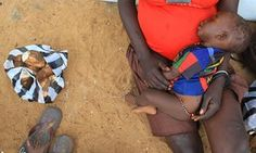 A mother and child at the UNHCR-managed refugees reception point at Elegu, Uganda