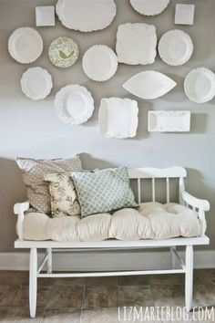 white dishes on grey wall