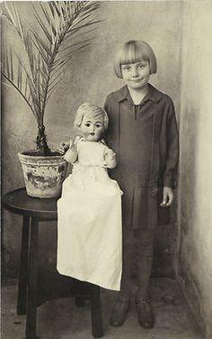 Child with doll, porcelain head doll, photo postcard circa 1930