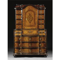 AN AUSTRIAN WALNUT VENEERED BUREAU CABINET, MID 18TH CENTURY Sotheby's